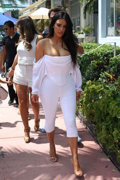 White on White Outfit Inspo | Kim was white hot in the Florida sun this weekend. The reality star went shopping in Miami Beach wearing a sexy, off-the-shoulder corset top by Givenchy with cropped white leggings and clear Yeezy heels.