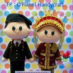 Indonesian felt doll bride and groom in army uniform traditional costume