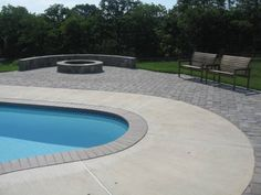 pavers around a pool. more expensive than poured concrete but no