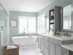 These are the perfect colors combos I love. We already have huge marble tiles like in photo and I love the gray cabinets with the blue-aqua walls. I also love the white quartz counters. Just beautiful. I just wonder what type of tiles to use in shower and as backsplash...