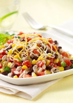 Spicy Barley and Black Bean Salad....Enjoy this refreshing black bean and barley salad with corn, green onion and Mexican blend cheese!