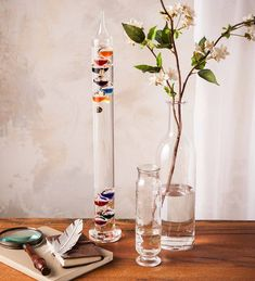 The Colorful Glass Tabletop Galileo Thermometer is a dramatic display of style and science. Based on a design by Galileo, this tall Galileo thermometer combines art with laws of physics to stimulate the inquisitive mind! Best Friend Gifts, Gifts For Friends, Galileo Thermometer, Weather Instruments, Impressive Image, Charitable Donations, Glass Globe, Glass Ball
