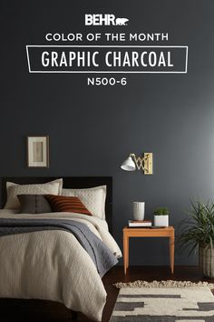 The Behr paint Color of the Month, Graphic Charcoal, is the perfect color for giving your bedroom a bold yet classic atmosphere. A dark and dramatic shade of gray, this wall color complements the neutral hues of the white bedspread, rug, and wood table. Click below to find more color inspiration.