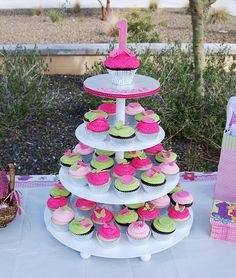 pink and green first birthday cupcake tower by Simply Sweets, via Flickr