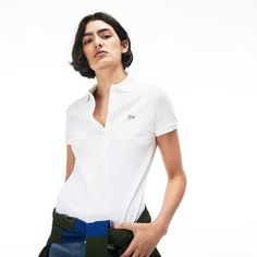Choose the comfort of stretch mini cotton piqué in this slim-fitting Polo Shirt. Signature feminine flair with refined mother-of-pearl buttons. Lacoste Polo Shirts, Slim Fit Polo Shirts, Polo Shirt White, Pique Polo Shirt, Lacoste Shoes Women, Venus And Serena Williams, Polo Shirt Design, Tennis Fashion, Women Sleeve