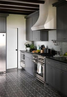 The gray is bit dark for me, but I might consider a lighter gray on the cabinets, with everything else the same. Love the floor.