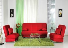 This green carpet and blindes go really well with the red couches and chairs. They make the white walled room pop.