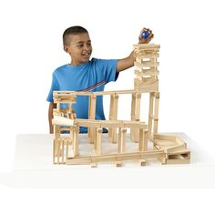 The finest in wooden children's toys. Tunnels, funnels, ramps and chutes, begin creating now! Contraptions is a 200-pc plank set that encourages creative problem solving through hands-on, active experimentation.