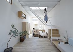 Wooden furniture forms sections of staircases at this house in Japan.