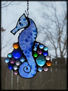 Sweet Baby Blue Catspaw Art Glass Seahorse. $89.00, via Etsy.