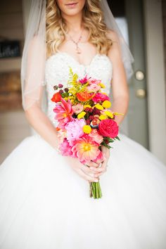 Colorful daisy, garden rose, peony and blllly ball bouquet. Photography: Shannon Leigh Anderson - shannonleighanderson.com/  Read More: http://www.stylemepretty.com/2014/06/09/casual-back-porch-wedding/