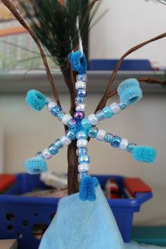 Snowflake ornament blue/white pony beads and blue pipe cleaners
