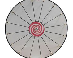 Prize Wheel Fun Brand 24 inch Dry Erase White Face  Wooden Clicker + Wooden Pegs = Awesome Clicking Sound  Guaranteed Perfect Balance  Excellent Spinning Motion and Clicking Sound  5 Year Replacement Guarantee  The prize wheel is cut from 1/8 inch hardboard and is guaranteed to be perfectly balanced. The prize wheel face is digitally printed and sealed with dry erase laminate which when used with a dry erase maker can be wiped clean with a dry cloth. Prize Wheel Fun brand products a...
