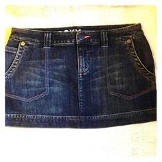 Roxy brand jean skirt size 5 Cute Roxy jean mini skirt with blue and pink stitching. This is a size 5 Roxy Skirts Mini