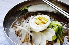 During the boiling days of summer, conversations among my Korean friends inevitably turn toward cravings for mul naengmyun, a dish of buckwheat noodles and cold, tangy broth topped with crisp cucumber, pear, and even a few ice cubes for extra chill factor.