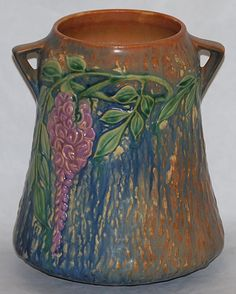 Roseville Pottery Wisteria Blue Vase.  I have this pattern in a piece that is a bit different in shape.  My aunt gave it to me.