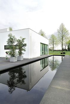 Maxim Winkelaar and Bob Ronday came together to complete Bemmel Residence, a private home located in Bemmel, The Netherlands. The minimalist exterior gives Houses Architecture, Residential Architecture, Interior Architecture, Interior Design, Villa Design, House Design, Swimming Pool House, Modern Pools, Cool Pools