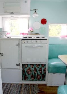 Fresh colors with vintage feel make this low brow luxury camping experience such a retreat. I love this little gal.