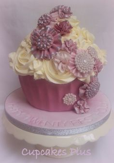 YES PLEASE.   Rosette and Brooch Giant Cupcake