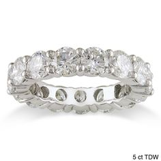 @Overstock - Make an unquestionable statement of love with this stunning 4 to 5 carat Miadora diamond eternity band. Gleaming with 15 to 18 prong-set diamonds, this brilliant band is perfect as a promise ring, a wedding ring, or an anniversary gift.http://www.overstock.com/Jewelry-Watches/Miadora-18k-Gold-Round-Diamond-Eternity-Band-G-H-I1-I2/2494822/product.html?CID=214117 $3,999.99