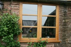 Wooden Oak Window with three panes of glass, solid glazing bars by www.brownsjoineryltd.com