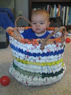 Toy basket! made from approx 400 plastic bags, single crochet around a braided plastic core :)