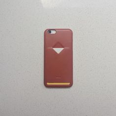 Bellroy Phone Case 1 Card in Tamarillo. Keep your main card close at hand for swiping and spending on the go. No more bulky pockets on a run, or digging for your wallet as you commute. Made from flexible polymer for strength, and full-grain leather so it feels great, we've made sure it only takes a swipe of your thumb to release the card. Available in sizes to fit iPhone 6s / 6s Plus / 6 / 6 Plus,