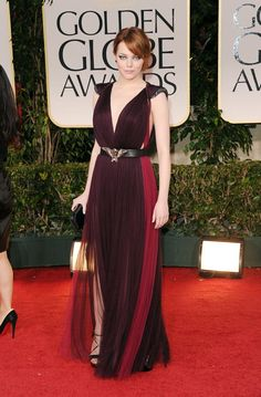 Pin for Later: 79 Big Reasons to Celebrate Emma Stone's Style  Emma channeled dark glamour on the 2012 Golden Globes red carpet in this two-toned Lanvin gown.