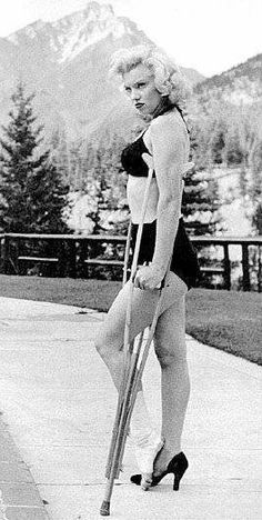 Marilyn Monroe on crutches, her face is priceless