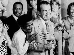 1972 ELECTION - Sammy Davis Jr. grabs PRESIDENT RICHARD NIXON from behind and squeezes his arms.  -- August 22, 1972