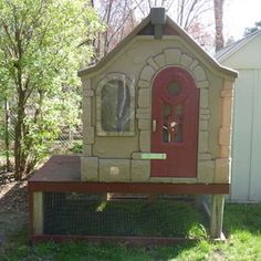 Old plastic playhouse used as coop.