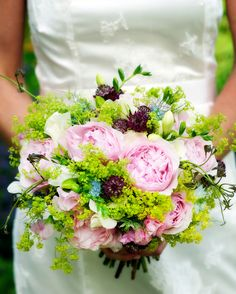 Roses, freesia, Lady's Mantle, Love in the Mist, sweet peas, and astrancia, were used in the bridal bouquet, made by Jane Pratt.