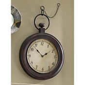 "Wall Clock, Pocket Watch   Classically simple. Uses 1 AA battery (not included). Metal. Approx. 20"" w x 28"" h x 2 1/2"" d; 16 1/2"" l chain. Available only in Bronze painted finish.  www.countrydoor.com"