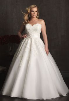 Brides.com: Designer Plus-Size Wedding Dresses We Love. Style W282, tulle wedding dress, price upon request, Allure Bridals