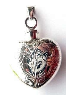 Large engraved silver ashes heart shape, screw top locket. £40