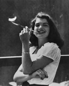 """Growing up was not so hard…. It happened gradually over the three years I spent trying to imitate girls who had callers every Saturday. I passed the finish line when I learned to smoke in the balcony of the Normandie Theater in New York from a girl who pressed a Longfellow upon me.""  -Jacqueline Bouvier Kennedy Onassis"