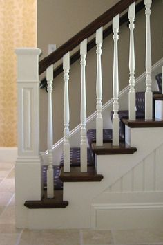 less expensive alternative. stained or painted railing and treads, white balusters white newel post