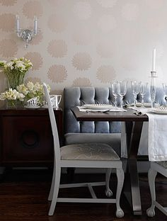 Love this color scheme and use of different seating ideas for one table