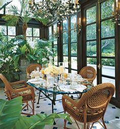 Built in 1913 for Burton E. Green, a founder of Beverly Hills, the home of Geoff and Anne Palmer received a thorough makeover from Los Angeles designer Craig Wright. The winter garden, a Neoclassical-style solarium that Wright conjured from an old plastic sunroom, is used as an informal dining area. | archdigest.com
