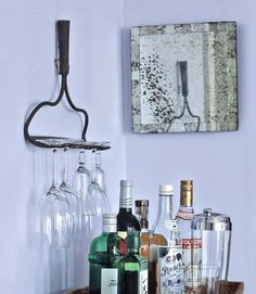 DIY Rake Stemware Holder~    Take advantage of your vertical wall space by hanging a rake head and suspending stemware from its tines. We found one of these rakes at the Country Living Fair in Columbus, Ohio, for $3, but you'll likely find them at a yard sale    Read more: Upcycled Crafts and Projects - Easy Upcycling Craft Ideas - Country Living
