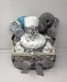 Adorable Diaper Cake Ideas – How To Make A Diaper Cake Elephant Baby Shower. An Elephant diaper cake gift basket. (gift it by grace). A unique diaper cake idea. Deco Baby Shower, Fiesta Baby Shower, Baby Shower Gift Basket, Shower Bebe, Baby Shower Gifts For Boys, Baby Shower Diapers, Baby Shower Parties, Baby Boy Shower, Baby Showers
