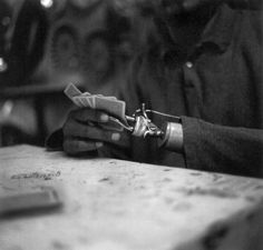 A one armed man playing solitaire in Nogales, Mexico - from a 2013 portfolio by documentary photographer Jackie Alpers.