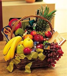 With all the favorites like fresh fruits, chocolates and cheeses, it's a classic example of just how great a basket can be. Suggest a large full size card for your message.   is fine selection for   Basket will be trimmed to suit the occasion on your card message. - $110.00 Available online for worldwide delivery at Brant Florist.