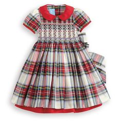 Utterly sweet with intricate smocking and peek-a-boo red lining. Available in Tartan.