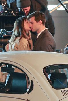 "Ahhh. I'm digging this now.  Guess pecks are the gateway kisses to S&M? | Here Is The First Kiss From The Set Of ""50 Shades Of Grey"""