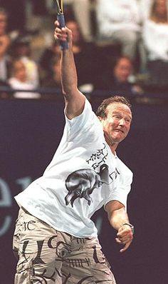 Robin Williams playing tennis.