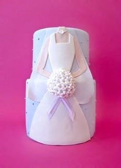 Michelle's Bridal Shower Cake - sheet cake, bride long ways obviously, flowers white with yellow dot in middle, green ribbon, pale pale color for background but not white obviously to show off the white veil and dress