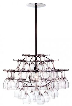 Glasklasen, The Glass Cluster, is a chandelier and at the same time a repository for drinking-glasses with stems, either with all glasses alike or of various combinations and colours.a genuine product of Swedish art industry, designed by a team of two architects - Gunnar Cedervall and Björn Stillefors - and an industrial designer - Jörgen Pudeck.