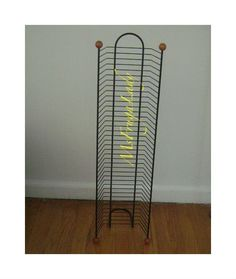 Place all those excess DVD Movie-Cases in this DVD FLOOR TOWER Rack. It holds 38 cases.  [MsFrugaLady on eBay, Media Storage Organizer]