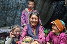 A Kham Tibetan family inside their yak wool tent in Lithang County in the Kham region at 4600 meters elevation. — in Lithang.